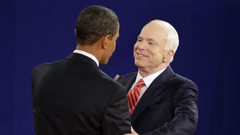 Barack Obama and John McCain greet each other at the start of a townhall-style presidential debate in 2008.