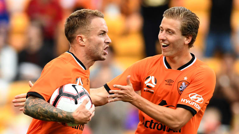 No time for celebrations: Adam Taggart looks to restart quickly after scoring the equaliser for Brisbane.