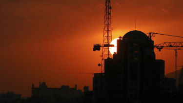 Buildings under construction are silhouetted against the setting sun in Tehran. Iran has threatened to increase its uranium enrichment above levels permitted by the 2015 accord.