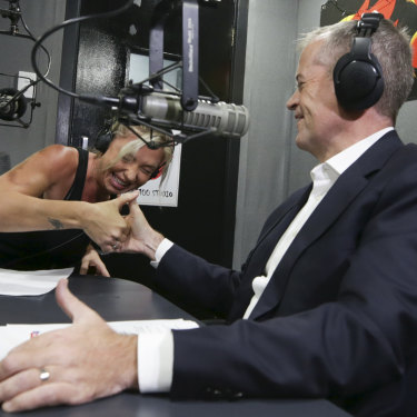 Opposition Leader Bill Shorten has a thumb war during a radio interview on Hot100 FM in Darwin.