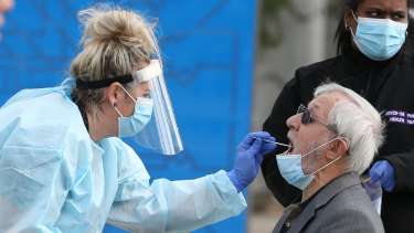 A man is tested at a pop-up testing site in Dallas.