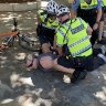Perth road rage driver arrested after tearing down climate change protesters' sign