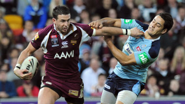 Darius Boyd tries to break free of a Jarryd Hayne tackle.