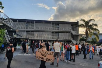 Protesters inside the grounds of the now empty Kangaroo Point hotel on Friday.