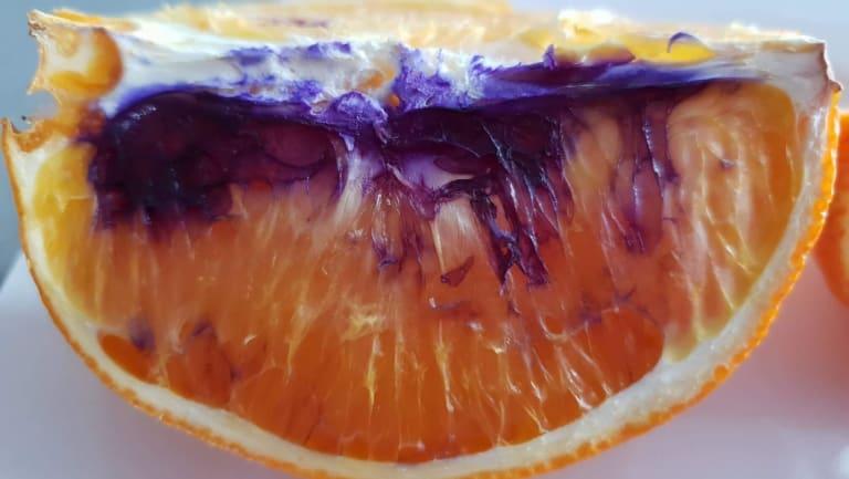 The left-over orange piece turned purple overnight.