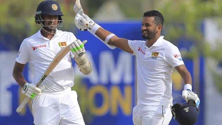Sri Lanka\'s Dimuth Karunaratne, right, celebrates scoring a century.