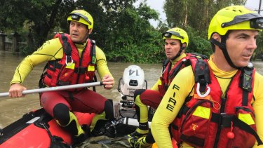 Queensland Fire and Emergency Services crews responding to flood conditions in Townsville.