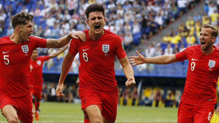 Heading for the semis:   Harry Maguire scores England's first goal against Sweden.