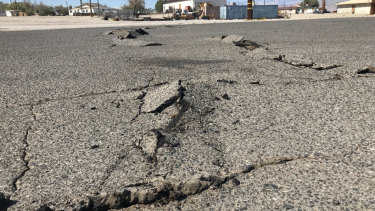 A road is damaged from an earthquake in Trona, California.