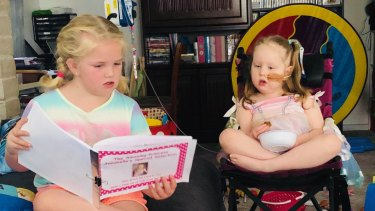 Ellie De Landre-Line reads Annabelle Potts the book she wrote for her: 'The Amazing Princess Annabelle's Special Selection'.