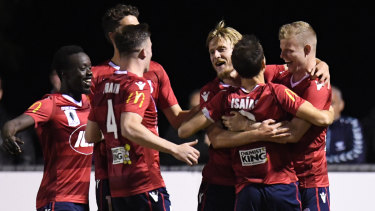 United players react after Jordan Elsey (right) scores against Bentleigh at Kingston Heath Soccer Complex in Melbourne.