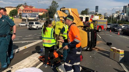 Motorists warned of peak delays after inner-city rollover leaves one injured