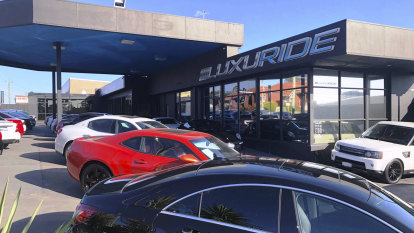 Luxury Perth car dealership, director banned from industry