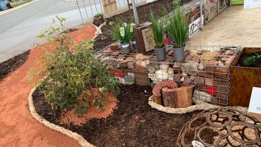 Waterwise landscaping, including trees that will one day shade the space.