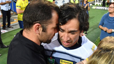 Old boys: Cameron Smith whispers to Johnathan Thurston in a touching gesture on the Gold Coast.