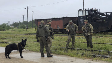 Soldiers search trains in Gillam.