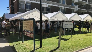 Massive lines form at COVID-19 clinics across Perth as arrivals from NSW rush to get tested.