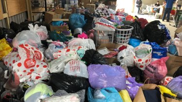 Piles of donations for bushfire victims in Cobargo.