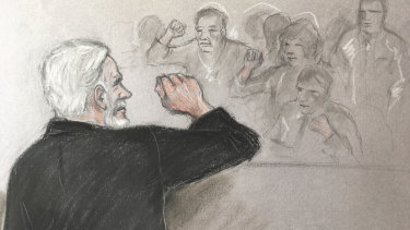 A court artist's sketch depicting Julian Assange, left, saluting his supporters as he appears at Southwark Crown Court in London.