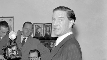 """Former British diplomat and journalist Harold """"Kim"""" Philby faces the media at his parents' London house in 1955."""