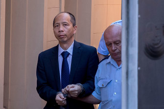 Robert Xie is led away in February 2017 after being given five life sentences.