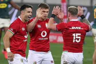 Conor Murray, Owen Farrell and Stuart Hogg celebrate.