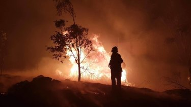 A firefighter douses the flames in Stanthorpe.
