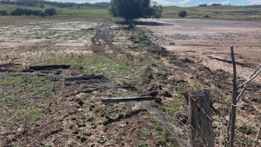The damage to Mr Orr's fences and paddocks from the rain.