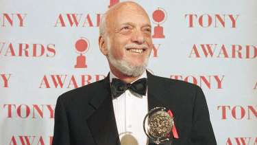 Harold Prince holds his Tony award for best director of a musical in 1995.