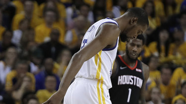 Massive loss: Kevin Durant limps off the court in the game five victory over Houston.