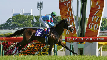 Almond Eye, ridden by Christophe Lemaire, wins the Victoria Mile turf race in Tokyo on May 17, 2020.