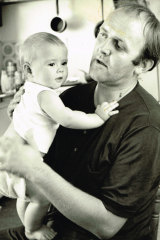 Louise Olsen as a baby with her father John.