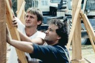 Richard Glover and Philip Clark build the frame of Richard's mud-brick house.