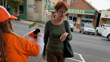 A One Nation volunteer in Bathurst also distributing Nationals how to vote cards.