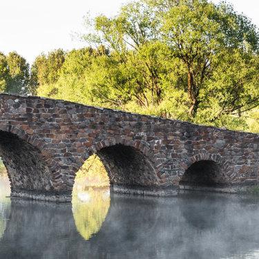 Linger on the palladian-style bridge for platypus-spotting at Mona Farm in Braidwood.