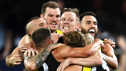 Tigers do it the hard way to win third flag in four years