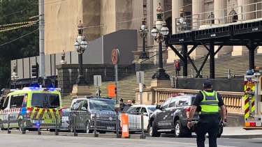 Dramatic scenes at Spring Street as a man was arrested after trying to set a white vehicle alight outside State Parliament.