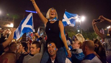 Supporters of the yes vote wait for the result of Scotland's September 2014 independence referendum.