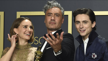 Adapted screenplay Oscar winner Taika Waititi (centre), with Natalie Portman and Timothee Chalamet, at the Oscars.