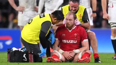 Alun Wyn Jones of Wales receives medical treatment at Twickenham.