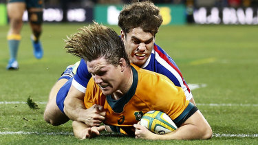 Michael Hooper goes over for a try.