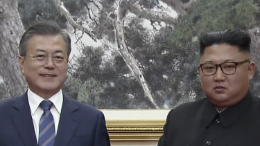 South Korean President Moon Jae-in, left, and North Korean leader Kim Jong-un pose after signing documents in Pyongyang, North Korea.