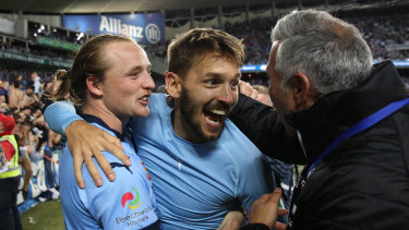 Best day of his life: Milos Ninkovic, centre, celebrates after his penalty earned Sydney FC the 2016-17 A-League title.
