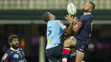 Bombs away: Kurtley Beale and Quade Cooper contest a high ball at the SCG.