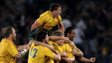 Kurtley Beale is mobbed by teammates after kicking a penalty in 2010 to help the Wallabies break a 47-year drought on the highveld.