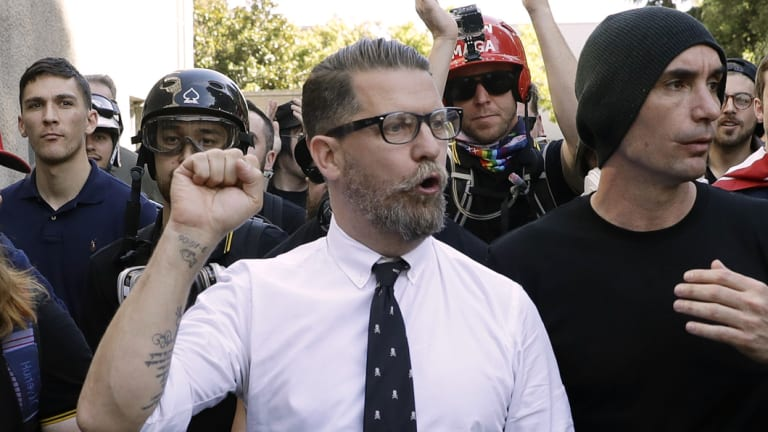 Gavin McInnes, centre, founder of the far-right group Proud Boys, is surrounded by supporters after speaking at a rally in Berkeley, California.
