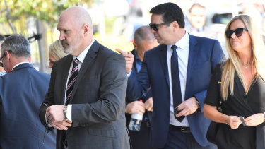 Jason Dunstall and Garry Lyon arrive for Danny Frawley's memorial service and funeral on Wednesday.