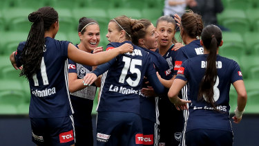 Cause for celebration: Melbourne Victory players gather in delight after Natasha Dowie opened the scoring against the Newcastle Jets at AAMI Park in Melbourne.