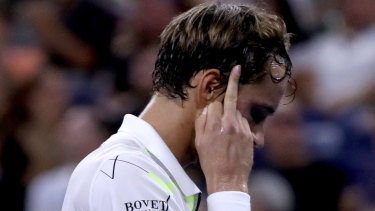 Up yours: Daniil Medvedev thought he was being subtle, until the image was shown on the big screen.