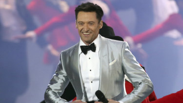 Hugh Jackman performs onstage at the Brit Awards.